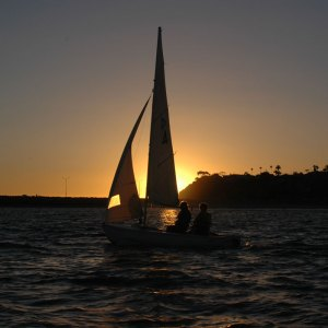 Tradewinds Literary Magazine photo of sailboat at sunset